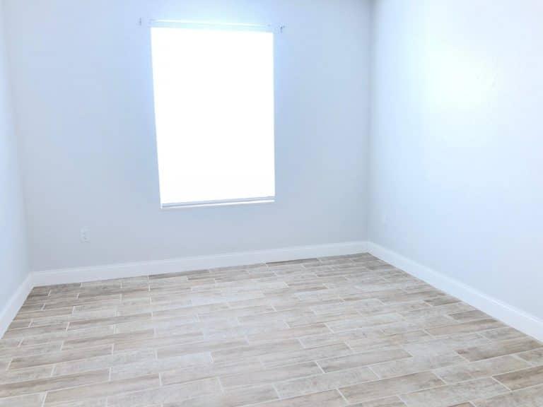 chambre lumineuse d'un appartement à vendre aux USA